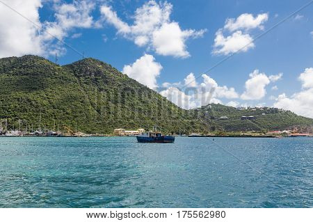 Old Blue Boat Moored by Green Hills in St Maarten