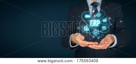 Enterprise resource planning ERP concept. Businessman offer ERP business management software for collect, store, manage, and interpret business data about customers, HR, production, logistics, financials and marketing.