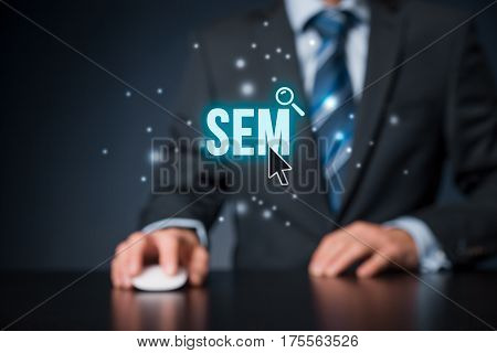 Search engine marketing - SEM concept. Businessman or programmer is focused to improve SEM and web traffic.