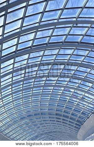 Interior of modern shopping mall with glass ceiling vertical image