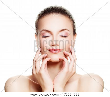 Relaxing Spa Model Woman with Healthy Skin Touching her Hands her Face Isolated. Spa Beauty and Cosmetology Concept poster