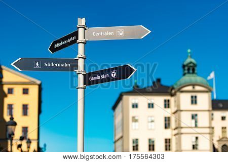 Gamla stan sign in foreground and old town architecture in background. Stockholm Sweden Scandinavia Europe.