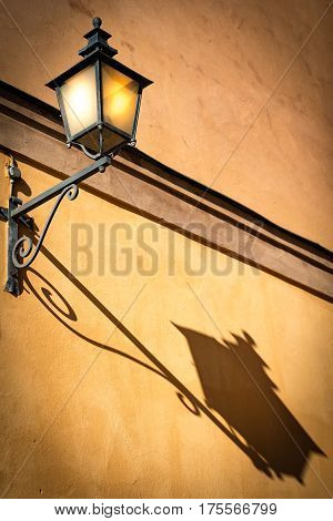 Old lantern on building wall in old town Gamla Stan of Stockholm Scandinavia Sweden Europe
