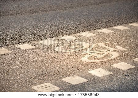 Icon of the bicycle on the ground. White symbol. Stockholm Sweden Scandinavia Europe.