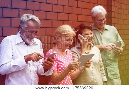 Senior Adult Use Tablet Mobile Phone Technology