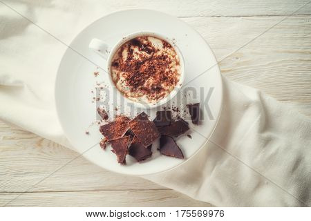 Mug of cocoa and chocolate on a plate