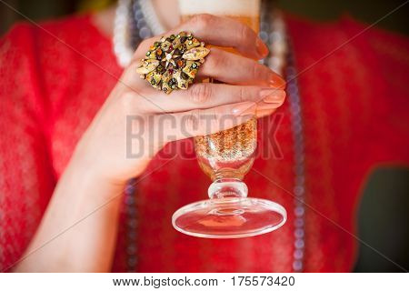 Woman's hand holding a glass of champagne. Close-up.