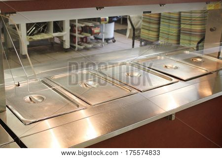 Stainless serving table in a school