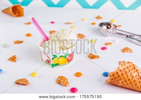 Close Up Fruit Ice-cream In A Paper Cup On The White Background With Colorful Candies, Pieces Of Waf