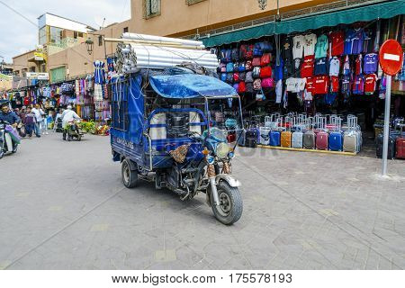 Marrakesh Morocco - March 04 2017: Auto driver unidentified by the narrow streets of the Medina of Marrakech. Chaotic transport through streets