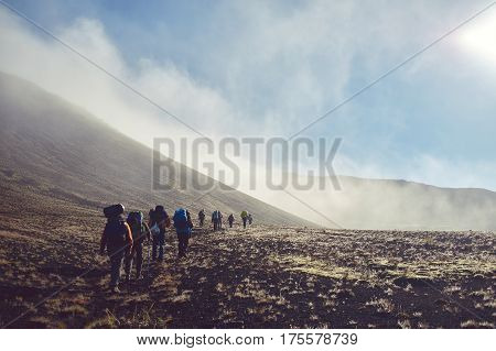 hikers on the trail in the Islandic mountains. Trek in National Park Landmannalaugar, Iceland. valley is in fog