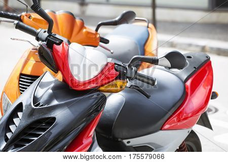 Close up of the scooters parked on the street