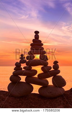 Stones balance on a background of sea sunset. Concept of harmony and balance
