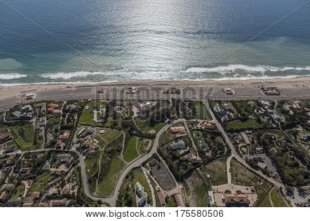 Aerial view of Zuma Beach, suburban streets, homes and estates in scenic Malibu, California.