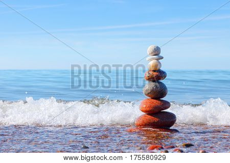 Concept of harmony and tranquility. Rock Zen near the sea. Balance and poise stones against the sea