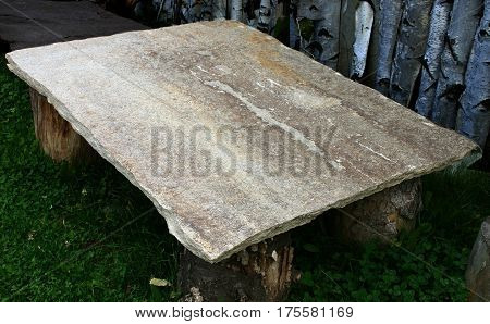 retro table of stone and wooden legs