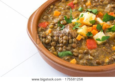 Lentil soup in a bowl isolated on white background