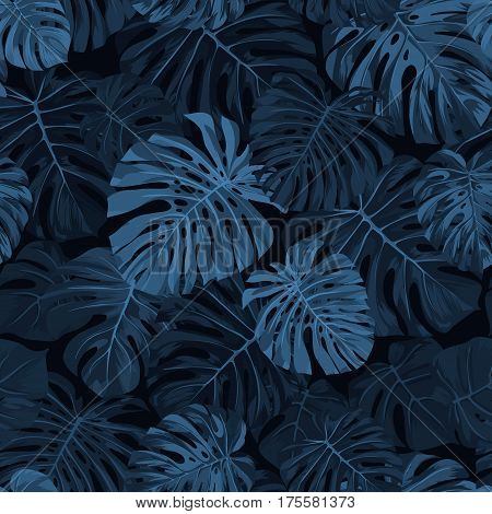 Dark blue indigo pattern with monstera palm leaves on dark background. Seamless summer tropical fabric design. Vector illustration.