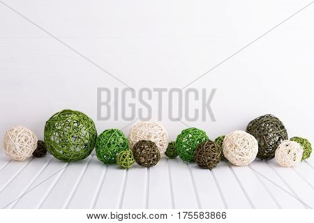 Background with rattan balls on white wooden table