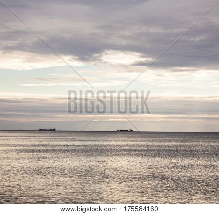 Ships lying at anchor in the roads in the Black Sea. Distant view.