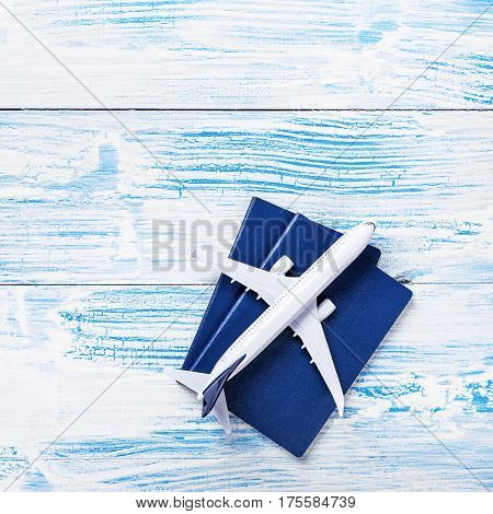 White Blank Model Of Passenger Plane And Passports On Wooden Background