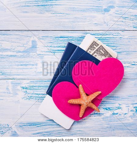 Heart Shapes And Starfish On Passports With Boarding Pass And Dollar Banknotes On  Wooden Background