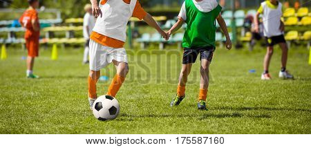 Children Training Soccer. Young Boys Playing Football Match on Pitch. Kids Running with Soccer Ball. Football Training Session for Kids