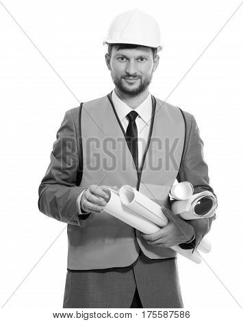 The best engineer. Black and white vertical studio shot of a confident male architect smiling to the camera posing on white background. professionalism builder business concept.