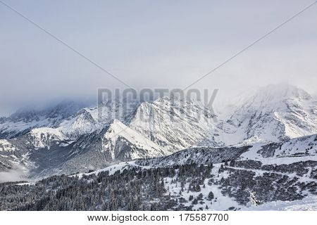 Heavy clouds covering the top of the mountains. Behind the clouds there is Mont Blanc the highest European mountain top.