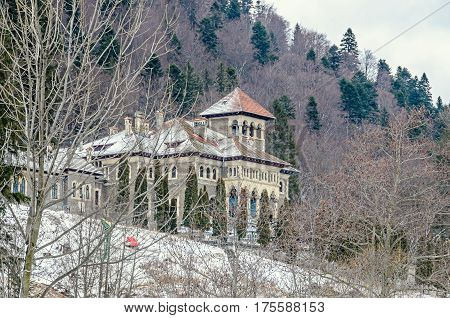 The Cantacuzino Palace (Palatul Cantacuzino) from Busteni Romania winter time with snow and ice.