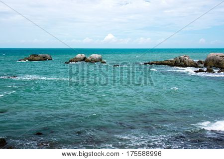 Natural small granite rock formation at sea in the afternoon Belitung Island Indonesia.