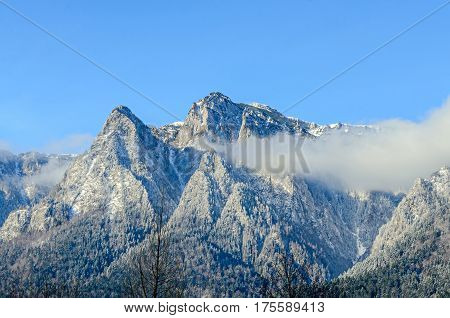 Carpathian Mountains, Bucegi With Caraiman Peak, Clouds, Snow And Fog, Winter Time Landscape