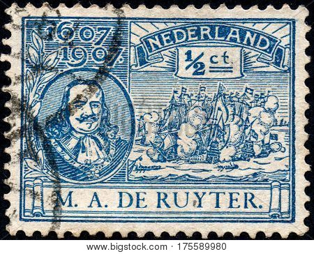 UKRAINE - CIRCA 2017: A stamp printed in Netherlands shows Ruyter and old sailing ship circa 1907