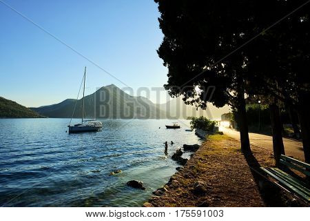 PERAST, MONTENEGRO - JULY 14, 2016: sunset on the coast of Perast in Kotor Bay