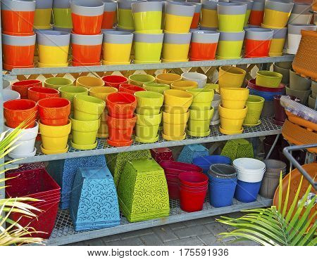 Colorful flowerpots on shelves at a nursery