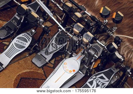 Rehearsal studio Minsk Belarus. Fabruary 25, 2017.A set of accessories for playing on the drum set. Warehousing of musical equipment. Twin pedals for drums from different manufacturers