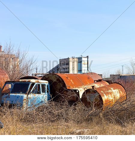 Old rusty truck with round cisterns. Crisis in Ukraine fall of economy, stop of production capacity. Global catastrophe.