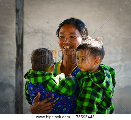 Burmese Woman With Two Boys At Countryside