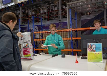 ST. PETERSBURG, RUSSIA - OCTOBER 27, 2016: Managers of Ulmart company at the service desk during the press tour. Ulmart is one of the largest Internet retailers in Russia