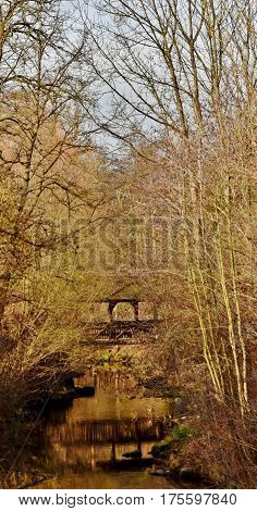 Winter Landscape wooden bridge over a creek
