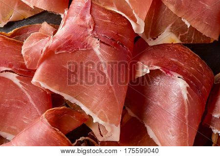 closeup of some delicious slices of spanish serrano ham