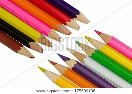Blunt and sharp colored pencils diagonally opposite each other