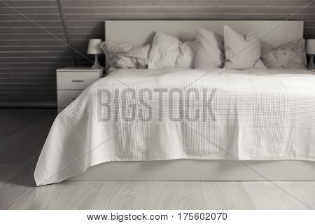 Bedroom in scandinavian style decorated white counterpane at rural wooden house nobody