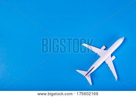 Model Of Passenger Plane On Blue Background