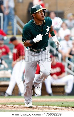 SCOTTSDALE, AZ-MAR 6: Oakland Athletics shortstop Addison Russell (17) runs the bases against the Arizona Diamondbacks at Salt River Fields at Talking Stick on March 6, 2014 in Scottsdale, Arizona.