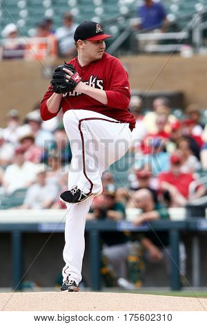 SCOTTSDALE, AZ-MAR 6: Arizona Diamondbacks pitcher Trevor Cahill pitches against the Oakland Athletics at Salt River Fields at Talking Stick on March 6, 2014 in Scottsdale, Arizona.