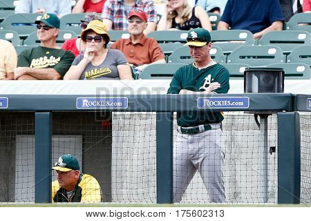 SCOTTSDALE, AZ-MAR 6: Oakland Athletics manager Bob Melvin (6) stands in the dugout against the Arizona Diamondbacks at Salt River Fields at Talking Stick on March 6, 2014 in Scottsdale, Arizona.
