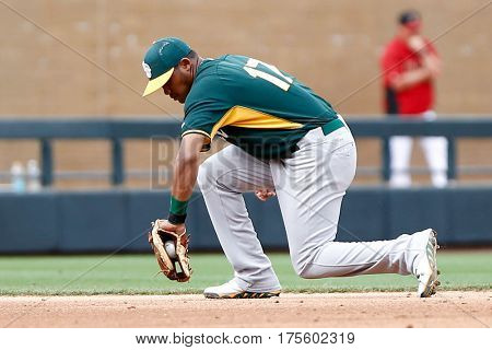 SCOTTSDALE, AZ-MAR 6: Oakland Athletics shortstop Addison Russell fields a ground ball against the Arizona Diamondbacks at Salt River Fields at Talking Stick on March 6, 2014 in Scottsdale, Arizona.