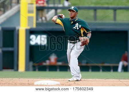 SCOTTSDALE, AZ-MAR 6: Oakland Athletics shortstop Addison Russell warms up against the Arizona Diamondbacks at Salt River Fields at Talking Stick on March 6, 2014 in Scottsdale, Arizona.