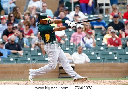 SCOTTSDALE, AZ-MAR 6: Oakland Athletics shortstop Addison Russell (17) swings at a pitch against the Arizona Diamondbacks at Salt River Fields at Talking Stick on March 6, 2014 in Scottsdale, Arizona.